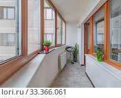 Купить «Small clean cozy balcony with windows and chair», фото № 33366061, снято 8 июля 2020 г. (c) Ольга Сапегина / Фотобанк Лори