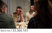 Купить «happy friends having christmas dinner at home», видеоролик № 33366181, снято 9 февраля 2020 г. (c) Syda Productions / Фотобанк Лори