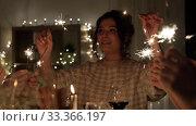 Купить «happy friends having christmas dinner at home», видеоролик № 33366197, снято 9 февраля 2020 г. (c) Syda Productions / Фотобанк Лори