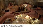 friends having christmas dinner at home. Стоковое видео, видеограф Syda Productions / Фотобанк Лори