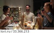Купить «happy friends drinking red wine at christmas party», видеоролик № 33366213, снято 9 февраля 2020 г. (c) Syda Productions / Фотобанк Лори