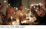 Купить «happy friends having christmas dinner at home», видеоролик № 33366221, снято 9 февраля 2020 г. (c) Syda Productions / Фотобанк Лори