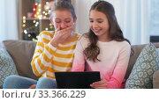 Купить «happy teenage girls with tablet computer at home», видеоролик № 33366229, снято 18 января 2020 г. (c) Syda Productions / Фотобанк Лори