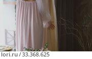 Girl examines her dress. Стоковое видео, видеограф Kozub Vasyl / Фотобанк Лори