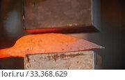 Купить «Forging industry - making a knife under pressure in the workshop», видеоролик № 33368629, снято 5 июня 2020 г. (c) Константин Шишкин / Фотобанк Лори