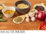 Купить «spices, onion, garlic, pine nuts and chili peppers», фото № 33368825, снято 6 сентября 2018 г. (c) Syda Productions / Фотобанк Лори