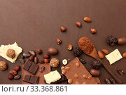 Купить «chocolate with nuts, cocoa beans and powder», фото № 33368861, снято 1 февраля 2019 г. (c) Syda Productions / Фотобанк Лори
