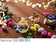 Купить «chocolate eggs and candy drops on wooden table», фото № 33368953, снято 22 марта 2018 г. (c) Syda Productions / Фотобанк Лори