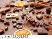 Купить «cocoa beans, chocolate, nuts and cinnamon sticks», фото № 33368993, снято 1 февраля 2019 г. (c) Syda Productions / Фотобанк Лори