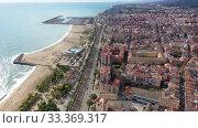Купить «Aerial view of Mataro with buildings and coast line in the Spain», видеоролик № 33369317, снято 24 ноября 2019 г. (c) Яков Филимонов / Фотобанк Лори
