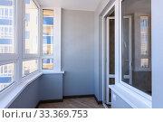 Glazed balcony in the new building, view of the entrance to the balcony. Стоковое фото, фотограф Иванов Алексей / Фотобанк Лори