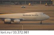 Купить «Airfreighter taxiing near cargo terminal», видеоролик № 33372981, снято 7 ноября 2019 г. (c) Игорь Жоров / Фотобанк Лори