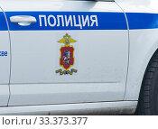 """Надпись """"Полиция"""" на автомобиле. Крупный план. Редакционное фото, фотограф E. O. / Фотобанк Лори"""