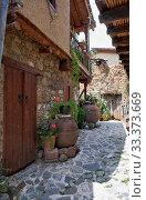 Купить «The narrow stone paved street of the old Kakopetria. Nicosia District. Cyprus», фото № 33373669, снято 11 июня 2018 г. (c) Serg Zastavkin / Фотобанк Лори