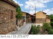 Купить «The narrow mediaeval street of old Kakopetria. Nicosia District. Cyprus», фото № 33373677, снято 11 июня 2018 г. (c) Serg Zastavkin / Фотобанк Лори