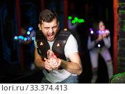 Young man on laser tag arena. Стоковое фото, фотограф Яков Филимонов / Фотобанк Лори