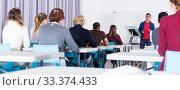 Купить «Students with teacher studying in classroom», фото № 33374433, снято 8 мая 2018 г. (c) Яков Филимонов / Фотобанк Лори