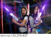 Girls back to back in colorful laser beams. Стоковое фото, фотограф Яков Филимонов / Фотобанк Лори