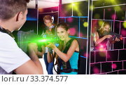 Купить «Two emotional players standing opposite each other with laser pi», фото № 33374577, снято 27 августа 2018 г. (c) Яков Филимонов / Фотобанк Лори