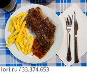 Купить «Appetizing beef entrecote with french fries served at plate, spanish cuisine», фото № 33374653, снято 4 апреля 2020 г. (c) Яков Филимонов / Фотобанк Лори