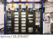 Купить «Server room with telecommunication racks», фото № 33374657, снято 9 июля 2020 г. (c) Яков Филимонов / Фотобанк Лори