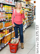woman choosing and buying refreshing fruit drinks. Стоковое фото, фотограф Яков Филимонов / Фотобанк Лори