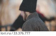 Russian folklore - men in sheepskin coats are dancing on a frosty day in the park. Стоковое видео, видеограф Константин Шишкин / Фотобанк Лори
