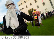 Купить «A radical student of the Universidad Nacional de Colombia shows a Molotov cocktail bottle during in a protest march against government's policies and corruption...», фото № 33380805, снято 24 октября 2019 г. (c) age Fotostock / Фотобанк Лори