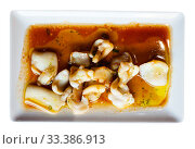 Купить «Fried cuttlefish in spicy sauce. Japanese food», фото № 33386913, снято 9 апреля 2020 г. (c) Яков Филимонов / Фотобанк Лори