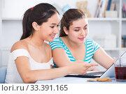 Cheerful teens girls using laptop. Стоковое фото, фотограф Яков Филимонов / Фотобанк Лори