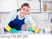 Купить «House worker woman is cleaning dust from the desk», фото № 33391181, снято 21 мая 2017 г. (c) Яков Филимонов / Фотобанк Лори