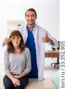 Купить «Young woman visiting male doctor oculist», фото № 33392805, снято 11 сентября 2019 г. (c) Elnur / Фотобанк Лори