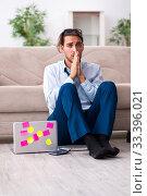 Купить «Young male businessman working at home», фото № 33396021, снято 9 августа 2019 г. (c) Elnur / Фотобанк Лори