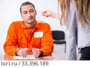 Купить «Young man meeting with advocate in pre-trial detention», фото № 33396189, снято 20 мая 2019 г. (c) Elnur / Фотобанк Лори