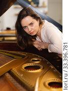 Young woman in an evening dress at the piano. Стоковое фото, фотограф Яков Филимонов / Фотобанк Лори