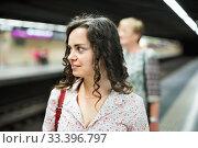 Купить «Woman commuter waiting train on public transport station», фото № 33396797, снято 11 июля 2020 г. (c) Яков Филимонов / Фотобанк Лори