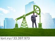Купить «Businessman and green oil energy concept», фото № 33397973, снято 30 марта 2020 г. (c) Elnur / Фотобанк Лори