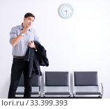 Купить «Man nervously impatiently waiting in the lobby», фото № 33399393, снято 18 января 2018 г. (c) Elnur / Фотобанк Лори