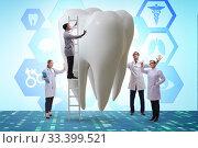 Купить «Doctors examining giant tooth in dental concept», фото № 33399521, снято 4 апреля 2020 г. (c) Elnur / Фотобанк Лори