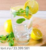 Купить «Glasss of mojito with lemon and drinking straw», фото № 33399581, снято 22 ноября 2017 г. (c) Elnur / Фотобанк Лори