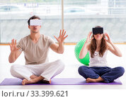 Man and woman with VR glasses meditating. Стоковое фото, фотограф Elnur / Фотобанк Лори