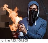 Rebel with molotov cocktail in dark room. Стоковое фото, фотограф Elnur / Фотобанк Лори