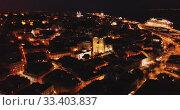 Купить «Night aerial view of downtown of Lisbon overlooking medieval Cathedral and Castle of Sao Jorge, Portugal», видеоролик № 33403837, снято 22 мая 2019 г. (c) Яков Филимонов / Фотобанк Лори