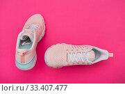Купить «Летние женские розовые кроссовки на розовом фоне», фото № 33407477, снято 9 марта 2020 г. (c) V.Ivantsov / Фотобанк Лори