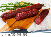 Купить «Russian dry smoked sausage with rosemary», фото № 33408993, снято 31 мая 2020 г. (c) Яков Филимонов / Фотобанк Лори