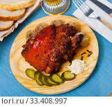 Купить «Oven baked pork knuckle with boiled onions and pickled cucumbers», фото № 33408997, снято 26 мая 2020 г. (c) Яков Филимонов / Фотобанк Лори