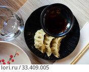 Купить «Japanese food gyoza dumplings with meat and shrimp», фото № 33409005, снято 9 апреля 2020 г. (c) Яков Филимонов / Фотобанк Лори