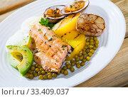 Купить «Trout fillets with dog cockles and vegetables», фото № 33409037, снято 4 августа 2020 г. (c) Яков Филимонов / Фотобанк Лори