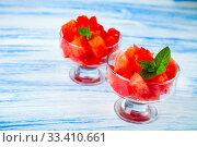 Купить «Pieces of watermelon and mint», фото № 33410661, снято 16 июля 2018 г. (c) Елена Блохина / Фотобанк Лори
