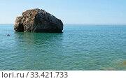Купить «Aphrodite's Stone on Petra tou Romiou or Aphrodite Rock Beach, one of the main attractions and landmarks of Cyprus island.», видеоролик № 33421733, снято 17 марта 2020 г. (c) Serg Zastavkin / Фотобанк Лори